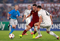Calcio, Champions League, Gruppo E: Roma vs CSKA Mosca. Roma, stadio Olimpico, 17 settembre 2014.<br /> Roma midfielder Alessandro Florenzi, left, is challenged by CSKA Moskva defender Sergei Ignashevic during the Group E Champions League football match between AS Roma and CSKA Moskva at Rome's Olympic stadium, 17 September 2014.<br /> UPDATE IMAGES PRESS/Isabella Bonotto
