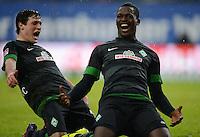 FUSSBALL   1. BUNDESLIGA   SAISON 2012/2013    19. SPIELTAG Hamburger SV - SV Werder Bremen                          27.01.2013 Assani Lukimya (re) und Zlatko Junuzovic (li, beide SV Werder Bremen)  jubeln nach dem 0:1