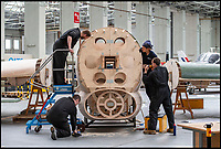 BNPS.co.uk (01202 558833)<br /> Pic: PhilYeomans/BNPS<br /> <br /> During construction...<br /> <br /> Super-sized Typhoon appears on a Dorset hillside...<br /> <br /> Apprentices working for QinetiQ at Boscome Down in Wiltshire have constructed a super-sized model of the Hawker Typhoon for the Chalke Valley History Festival near Salisbury this week.<br /> <br /> The huge 4x scale model of the rocket carrying fighter has been placed on a hillside overlooking the Festival that opened yesterday. <br /> <br /> The fighter bomber known as 'Tiffy' by its pilots played a key role attacking German troops, tanks and trains during the battle for Normandy, disrupting Nazi attempts to resupply their beleagured forces. <br /> <br /> There are no airworthy Typhoon's still flying today, although the Typhoon Preservation Trust has plans to restore one to flying condition by 2020.