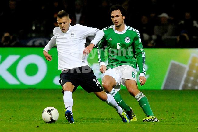 BREMEN - Voetbal, Duitsland - Frankrijk, vriendschappelijke interland, Weser stadion, 29-02-2012,   Jeremy Menez (l) met Mats Hummels (r).