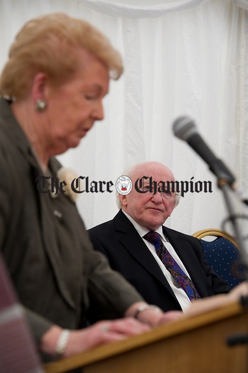 President Michael D Higgins looks on as Lillian Sullivan, Director of the Alzheimers Society of Ireland addresses the gathering at the official opening of the Watermans Lodge day Care and Respite centre at Ballina. Photograph by John Kelly.