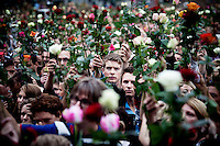 Oslo, Norway, 25.07.2011. People gathered in thousands to commemorate the dead in front of the Oslo city hall in a rose parade. On 22 July 2011, Anders Behring Breivik bombed the government buildings in Oslo, which resulted in eight deaths. He then carried out a mass shooting at a camp of the Workers' Youth League (AUF) of the Labour Party on the island of Utøya where he killed 69 people, mostly teenagers. Photo: Christopher Olssøn. ..----------------------------..-ITALY OUT-..----------------------------