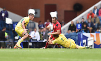 Wales's Gareth Davies is tackled by Australia's Jesse Parahi<br /> <br /> Australia Vs Wales - Men's quarter-final<br /> <br /> Photographer Chris Vaughan/CameraSport<br /> <br /> 20th Commonwealth Games - Day 4 - Sunday 27th July 2014 - Rugby Sevens - Ibrox Stadium - Glasgow - UK<br /> <br /> © CameraSport - 43 Linden Ave. Countesthorpe. Leicester. England. LE8 5PG - Tel: +44 (0) 116 277 4147 - admin@camerasport.com - www.camerasport.com