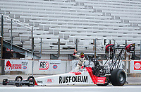 Jul 11, 2020; Clermont, Indiana, USA; NHRA top fuel driver T.J. Zizzo waves in front of empty grandstands during qualifying for the E3 Spark Plugs Nationals at Lucas Oil Raceway. This is the first race back for NHRA since the start of the COVID-19 global pandemic. Mandatory Credit: Mark J. Rebilas-USA TODAY Sports