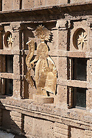 The terracotta brickwork used throughout La Scarzuola is decoratd with gilded anecdotal sculptures