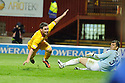MOTHERWELL'S ROBERT MCHUGH HEADS THE BALL IN TO THE NET BUT IT'S RULED OFF SIDE