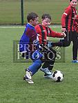 EMU Rockets Eoin Johnston Drogheda Town Daniel Brady. Photo:Colin Bell/pressphotos.ie