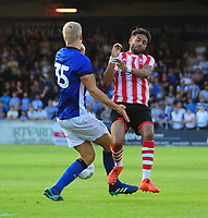 Lincoln City's Bruno Andrade vies for possession<br /> <br /> Photographer Chris Vaughan/CameraSport<br /> <br /> Football Pre-Season Friendly - Lincoln City v Sheffield Wednesday - Friday 13th July 2018 - Sincil Bank - Lincoln<br /> <br /> World Copyright &copy; 2018 CameraSport. All rights reserved. 43 Linden Ave. Countesthorpe. Leicester. England. LE8 5PG - Tel: +44 (0) 116 277 4147 - admin@camerasport.com - www.camerasport.com