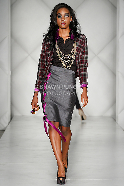 """Model walks runway in an outfit from the Marcella Co Fall 2014 """"Rustic Sophistication"""" collection by Marcella Jones-Penn, during Fashion Week Brooklyn Fall Winter 2014, day two at Industry City, on March 14, 2014."""