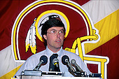 Washington Redskins general manager Charley Casserly discusses the team's first draft choice during a press conference at Redskins Park in Herndon, Virginia on April 22, 1990.  They took their top pick, Andre Collins of Penn State, with the 46th pick of the draft in the second round. The Redskins did not have a first round draft choice after trading it to the Atlanta Falcons for Gerald Riggs.  <br /> Credit: Arnie Sachs / CNP