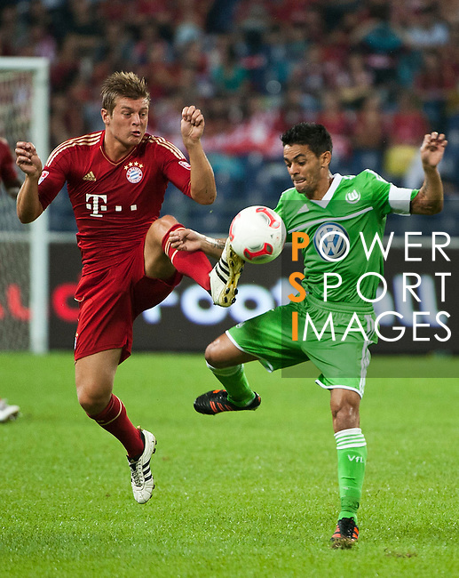 GUANGZHOU, GUANGDONG - JULY 26:  Toni Kroos (L) of Bayern Munich and Josue of VfL Wolfsburg fight for a ball during a friendly match as part of the Audi Football Summit 2012 on July 26, 2012 at the Guangdong Olympic Sports Center in Guangzhou, China. Photo by Victor Fraile / The Power of Sport Images *** Local Caption *** Toni Kroos; Josue