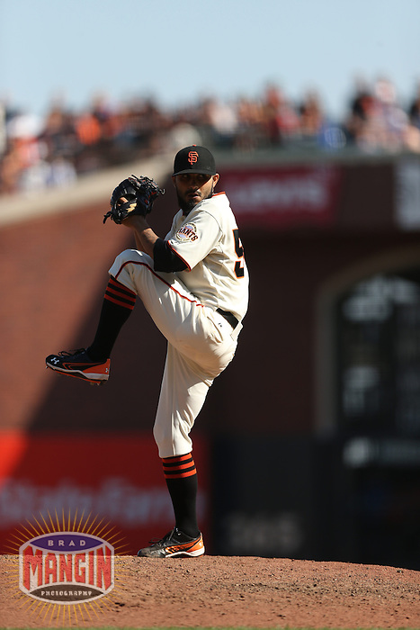 SAN FRANCISCO - SEPTEMBER 27:  Sergio Romo of the San Francisco Giants pitches during the game against the Arizona Diamondbacks at AT&T Park on September 27, 2012 in San Francisco, California. (Photo by Brad Mangin)