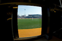 A view from inside the manually operated scoreboard in left field at Wake Forest Baseball Park during the game between the Virginia Cavaliers and the Wake Forest Demon Deacons on April 6, 2013 in Winston-Salem, North Carolina.  (Brian Westerholt/Four Seam Images)