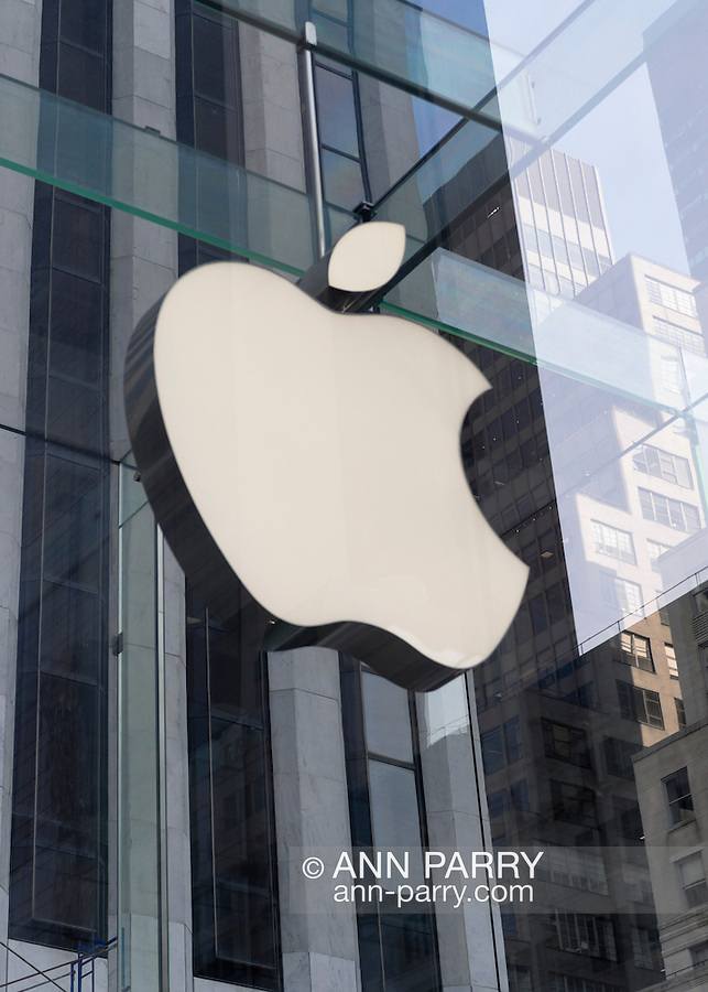 NYC, New York, U.S.  21st May 2013. This large white Apple logo is suspended in the 32-foot structural glass cube entrance to the Apple store at 767 Fifth Avenue between 58th and 59th Streets, in Manhattan.