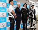 November 21, 2016, Tokyo, Japan - Japan's Tsukuba University professor and high-tech venture Cyberdyne president Yoshiyuki Sankai (2nd R) shakes hands with insurance company AIG Japan Holdings president Robert Noddin (L) as they exchange documents on their agreement for business collaboration at a press conference at AIG Japan headquarters in Tokyo on Monday, November 21, 2016. AIG Japan will develop insurance products and related services using Cyberdyne's robot suit Hybrid Assistive Limb (HAL) and other technologies such as vital sensors.   (Photo by Yoshio Tsunoda/AFLO) LWX -ytd-