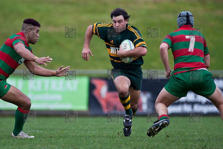 Armyn Sanders goes for the gap between Tevita Finau and Matty Hamilton. Counties Manukau McNamara Cup Premier Club Rugby final between Pukekohe andWaiuku, held at Bayer Growers Stadium, on Saturday July 17th. Waiuku won 25 - 20.