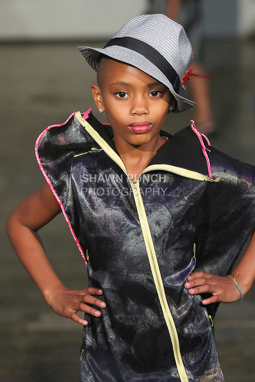 Model walks runway in an outfit from the Amparo3 Spring Summer 2016 collection by Iliana Quander, during Fashion Week Brooklyn Spring Summer 2016.