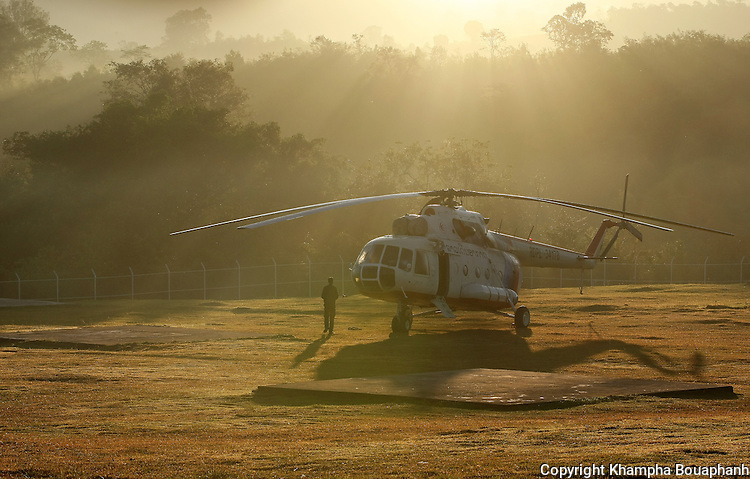 A Lao helicopter crew member makes a safety check on a copter that will take JPAC personal to their dig site near Ta Oy, Laos on Wednesday, November 7, 2012. (Star-Telegram/Khampha Bouaphanh)