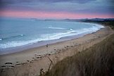 NEW ZEALAND, Oamaru, Man Running on the Beach at sunrise, Ben M Thomas