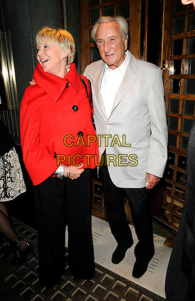 MICHAEL WINNER & GUEST.Spotted outside The Ivy restaurant, London, England, April 18th 2008..full length red coat jacket grey gray suit white shirt trousers.CAP/CAN.©Can Nguyen/Capital Pictures