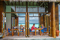 Maldives, Rangali Island. Conrad Hilton Resort. Couple at the Mandhoo organic restaurant over the ocean (MR).