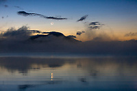 Moonrise over the Kejulik mountains and Naknek lake, Katmai National Park, Alaska.