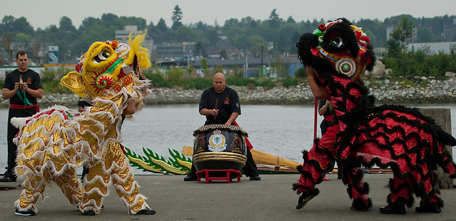 """Vancouver, Canada, Aug 8th 2009. World Police and Fire Games, Dragon Boat Competition.  Performers from the Vancouver Police Department's Lion Dance team perform the """"Awaken the Dragon"""" ceremony to mark the beginning of the WPFG's Dragon Boat competition.  Photo by Gus Curtis"""
