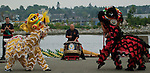 "Vancouver, Canada, Aug 8th 2009. World Police and Fire Games, Dragon Boat Competition.  Performers from the Vancouver Police Department's Lion Dance team perform the ""Awaken the Dragon"" ceremony to mark the beginning of the WPFG's Dragon Boat competition.  Photo by Gus Curtis"