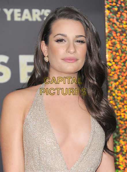 "Lea Michele.The World Premiere of ""New Year's Eve' held at The Grauman's Chinese Theatre in Hollywood, California, USA..December 5th, 2011.headshot portrait beige gold sparkly halterneck plunging neckline cleavage .CAP/RKE/DVS.©DVS/RockinExposures/Capital Pictures."