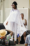 Model walks during Harlem Week 2017 at 135th Street and St. Nicholas Avenue in New York City on August 19, 2017.