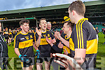 Tony Brosnan, Luke Quinn John Payne and Michael Moloney Dr. Crokes players and supporters celebrate defeating Corofin in the Semi Final of the Senior Football Club Championship at the Gaelic Grounds, Limerick on Saturday.