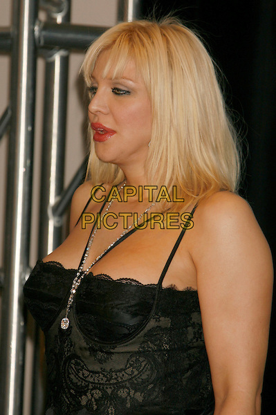 COURTNEY LOVE.2006 Billboard Music Awards held at the MGM Grand Hotel and Casino, Las Vegas, Nevada, USA..December 4th, 2006.half length black lace necklace.CAP/ADM/RE.©Russ Elliot/AdMedia/Capital Pictures