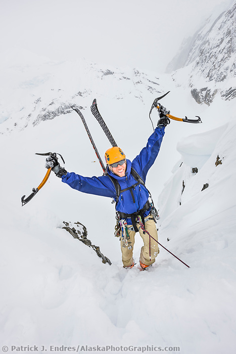 Tim Banfield climbs a rocky slope in the Alaska range mountains, interior, Alaska.