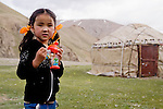 Kyrgyz girl near yurt in mountains, Besh Moinok, Tien Shan Mountains, eastern Kyrgyzstan
