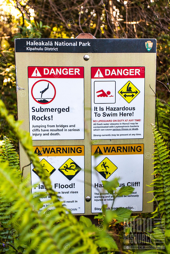 Warning signs at the Pipiwai hiking trail, Haleakala National Park, Kipahulu, Maui
