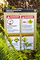 Warning signs at the Pipiwai hiking trail, Haleakala National Park, Kipahulu, Maui