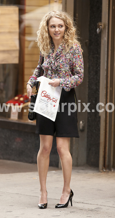 "**ALL ROUND PICTURES FROM SOLARPIX.COM**                                             **SYNDICATION RIGHTS FOR UK, AUSTRALIA, DENMARK, PORTUGAL, S. AFRICA, SPAIN & DUBAI (U.A.E) & ASIA (EXCLUDING JAPAN) ONLY**                                                                                  Caption:  Filming of ""The Carrie Diaries"" TV Series Filming at Century 21 in Downtown New York City on March 25, 2012 - Century 21 - New York City, NY, USA                                                                              This pic:                                                                                              Anna Sophia Robb.JOB REF:  14608      PHZ/mayer       DATE: 25.03.2012                                                           **MUST CREDIT SOLARPIX.COM OR DOUBLE FEE WILL BE CHARGED**                                                                      **MUST AGREE FEE BEFORE ONLINE USAGE**                               **CALL US ON: +34 952 811 768 or LOW RATE FROM UK 0844 617 7637**"