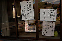 Sarcastic messages in an empty shop for any visitors to the abandoned village of Tsushima in Fukushima, Japan. Friday May 4th 2012. After the explosions at the daichi nuclear plant caused by the March 11th 2011 earthquake and tsunami, high levels of radiactive contamination in this village has made it uninhabitable.