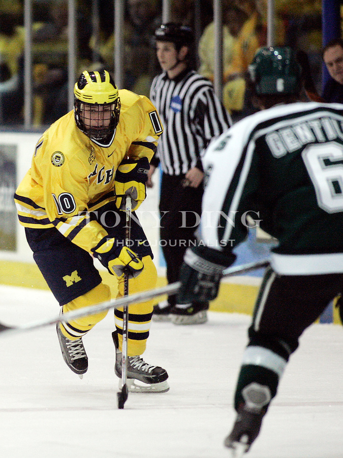 4 November 2006: Michigan sophomore Travis Turnbull (10) dribbles the puck, covered by MSU defender Brandon Gentile (6), during a CCHA conference ice hockey game between Michigan and in-state rival Michigan State, at Yost Ice Arena in Ann Arbor, MI. Michigan won the game 6-2.