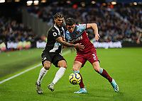 2nd November 2019; London Stadium, London, England; English Premier League Football, West Ham United versus Newcastle United; Aaron Cresswell of West Ham United challenges DeAndre Yedlin of Newcastle United - Strictly Editorial Use Only. No use with unauthorized audio, video, data, fixture lists, club/league logos or 'live' services. Online in-match use limited to 120 images, no video emulation. No use in betting, games or single club/league/player publications