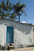Goias Velho, Brazil. Well preserved colonial town; colonial architecture; blue door in a white wall.