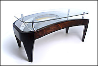BNPS.co.UK (01202 558833)<br /> Pic: FallenFurniture/BNPS<br /> <br /> Coffee table - Formally Airbus A320 fueslage.<br /> <br /> Aircraft scrap turn's into creative furniture.<br /> <br /> A British company has hit upon the unique idea of turning scrapped aircraft into stunning items of furniture.<br /> <br /> Fallen Furniture take's the wheels, engines, wings and even bomb housings from old aeroplanes and turn's them into highly polished 'statement peices' for contempary homes and office's.<br /> <br /> Director Ben Tucker says, 'Aircraft are made of the ultimate materials to an exacting standard, and its a pleasure to give these beautiful items a second life as bespoke furniture.'