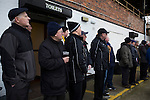 Prescot Cables 2 Brighouse Town 1, 13/02/2016. Hope Street, Northern Premier League. Home supporters in the enclosure watching the first-half action as Prescot Cables take on Brighouse Town in a Northern Premier League division one north fixture at Valerie Park. Founded in 1884, the 'Cables' in their name came from the largest local employer, British Insulated Cables and they have played in their current ground, also known as Hope Street, since 1906. Prescott won the match 2-1 watched by a crowd of 189. Photo by Colin McPherson.