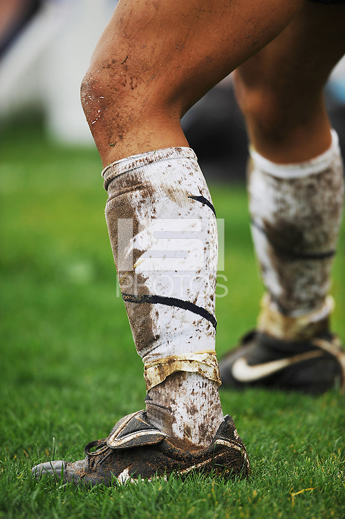 Muddy sock and boot