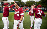 STANFORD, CA - April 23, 2011: Rusty Filter of Stanford baseball congratulates the team after Stanford's game against UCLA at Sunken Diamond. Stanford won 5-4.