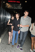 July 10, 2012 Anne Hathaway and her fiancé Adam Shulman attend the NY premiere screening of  Shut Up and Play the Hits at Village East Theater in New York City. © RW/MediaPunch Inc.
