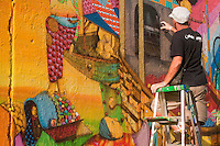 OS Gemeos completes a new mural on East Houston Street