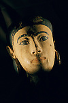 A stucco, painted wooden head  used as a wig stand, New Kingdom