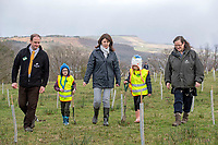 Pictured: with Blaendulais primary school (Seven Sisters) pupils Alfie (9) and Dempsey (8) are Lesley Griffiths (AM), Minister for Enviroment, Energy and Rural Affairs (middle),  Chris Matts, Woodland Trust Manager for South and West Wales (left) and Natalie Buttriss, Director of Wales - The Woodland Trust/Coed Cadw (right)<br /> Re: National Forest launch at the Woodland Trust event high on the mountainside above Neath in South Wales this morning at the newly planted Coed Cadw woodland.