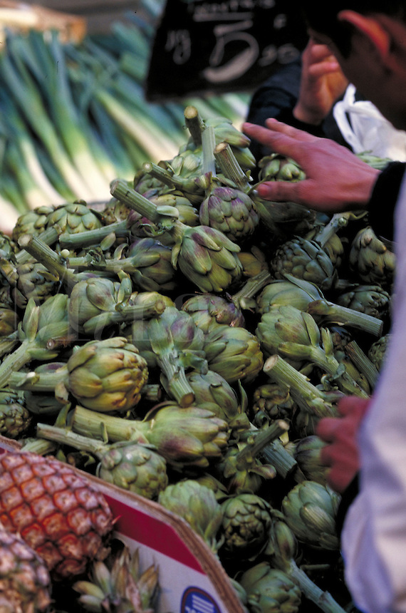 Artichokes being sold in a street market. Paris, France Place D'Aligers street market.